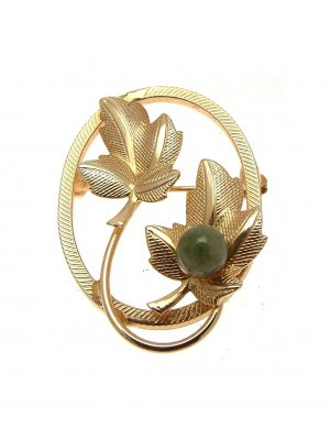 Ladies vintage brooch with leaf and green centre design 34
